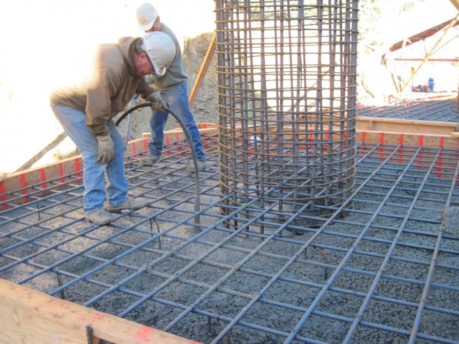 Pouring of foundations for wind fencing dust control for mining