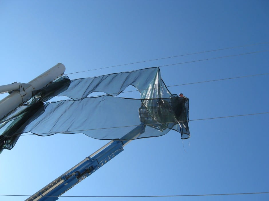 Fabric installation for dust control - Dust control wind fence
