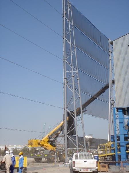 Wind fence in Oman - Installing fabric on a dust control wind fencing in Oman 30m x 3200m around a steel pelletizing plant