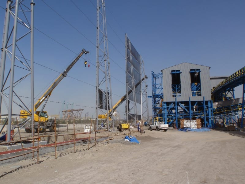 Wind fence fabric installation - 30 m (100 ft) x 3200 m (10500 ft) wind fencing around a steel manufacturing facility